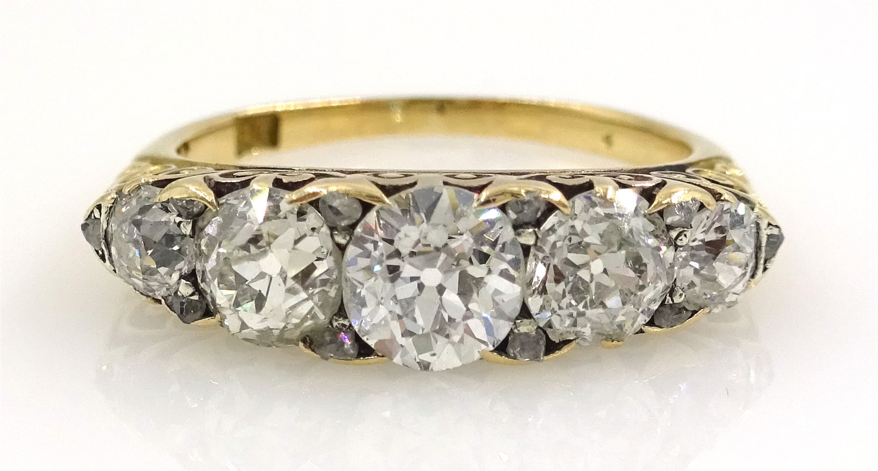 18ct Gold Ring set with five graduated old cut diamonds