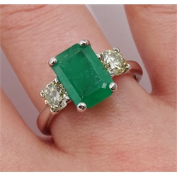 18ct white gold three stone emerald cut emerald and round brilliant cut diamond ring, emerald 1.92 carat, total diamond weight 0.81 carat, with World Gemological Institute certificate