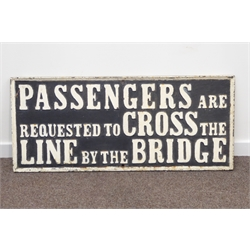 Cast-iron railway sign - 'Passengers are requested to cross the line by the bridge', white letters on black ground, 47 x 111cm