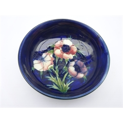 Moorcroft footed bowl decorated in the Anemone pattern, impressed Potter to H.M the Queen & signed, D11cm