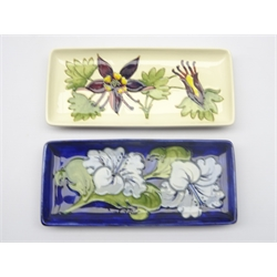 Two Moorcroft rectangular trays decorated in the Hibiscus and Columbine pattern, L21cm (2)