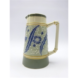 James Macintyre & Co. 'Gesso Faience' tapered jug designed by William Moorcroft with floral tube lined decoration and reeded handle,  impressed no. M338, H17.5cm