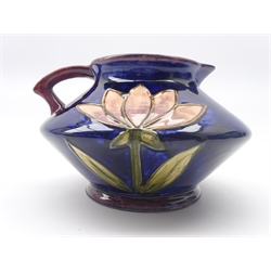 Old Ellgreave pottery jug designed by Lorna Bailey, decorated in the Moorcroft style with stylized flowers, L20cm
