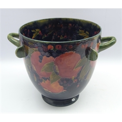 Moorcroft two handled jardiniere decorated in the fruit and berries pattern with applied lappets, green signature mark to base and dated 1918 H27cm x D26cm