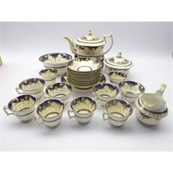 19th century tea service, gilded with crosses and scrolls on cobalt blue ground, pattern no. 232 (36)