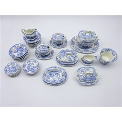 19th century Children's miniature dinner service, transfer printed with blue and white Chinoiserie pattern comprising dinner plates, side plates, bowls, tureens and stands, gravy boats etc (44)