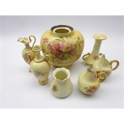 Group of early 20th century Royal Worcester blush ivory ceramics comprising a vase painted with bird, shape no. G957, potpourri base no. 1286, pedestal ewer no. 1144, two handled vase no. 1399, two jugs no. 1094 and matched candlestick (7)