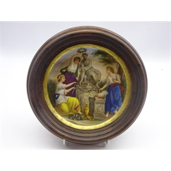 Vienna porcelain plaque painted with three figures decorating a statue, titled 'Opfer' within a gilded border signed Weber, mounted in wooden frame, D15.5cm