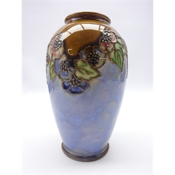 Royal Doulton stoneware ovoid vase, tube lined with fruiting foliate shoulders on blue and brown ground, no. 1638, H17.5cm