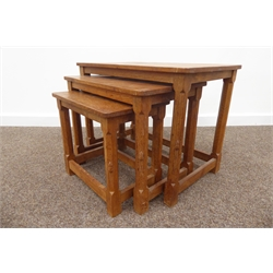 'Mouseman' adzed oak rectangular nest of three tables, octagonal legs with stretcher bases, signature to all, W64cm, H47cm, D38cm