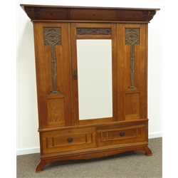 Large late 19th/early 20th century oak Art Nouveau wardrobe, cornice corners carved with interlaced leafage, centre bevelled mirror glazed doors enclosed by floral and leaf carved panels, two ash lined drawers to base with heart shaped metal plates, splayed supports, fabric lined interior fitted with hooks, retailed by 'Hudson & Hepper Leeds' plaque to rear, W176cm, H212cm, D61cm