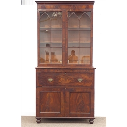 Georgian mahogany secretaire bookcase, projecting cornice above two astragal glazed doors, fall front drawers with rosewood interior fitted with baize lined writing surface, drawers and pigeon holes, panelled double cupboard, on turned feet, W120cm, H242cm, D57cm