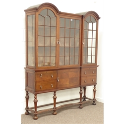 Late 19th century mahogany display cabinet, double arched top with dentil cornice, three astragal glazed doors above four drawers and cupboard, turned supports with shaped moulded stretchers, bun feet, W160cm, H200cm, D40cm
