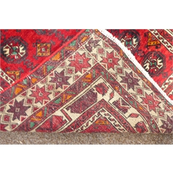 Persian Baluch runner rug, red ground with repeating Gul motifs, 280cm x 90cm