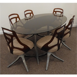 1970s dining table, oval smoked glass top on twin chromed metal pillars with splayed supports (166cm x 106cm, H74cm), and set six matching dining chairs, brown plastic backs stamped 'EST 4001 Grafton , WIS'