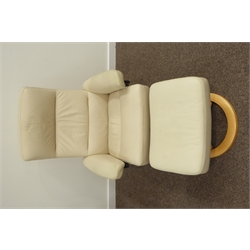 Ekornes 'Stressless' reclining and swivel armchair and matching footstool, upholstered in cream leather