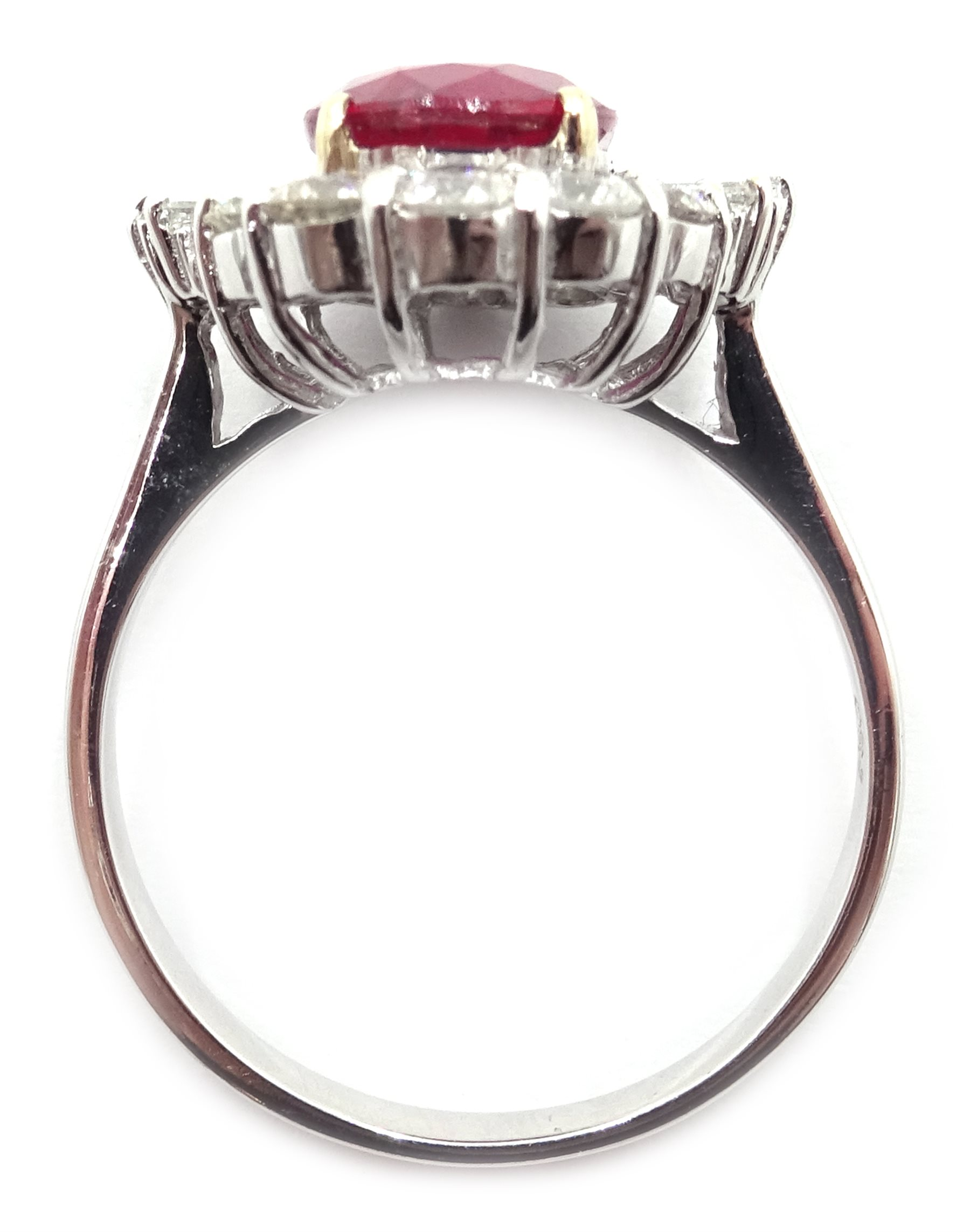 18ct white gold ruby and diamond cluster ring, stamped 750