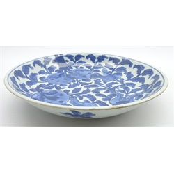 Chinese Kang Hsi shallow bowl decorated with fruit and flowers in blue and white 26cms Diam