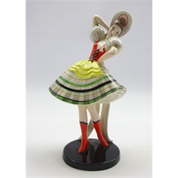 Goldscheider model of a woman dressed in a dirndl no. 7558 H25cm