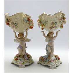 Pair late 19th century porcelain centrepiece vases, shell shaped bowl supported by winged cherubs surrounded by fruit & flowers, H33cm