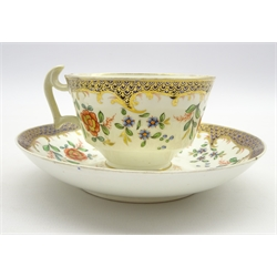 Early 19th Century Swansea tea cup and saucer of London shape decorated with floral sprays and with red 'Swansea' mark