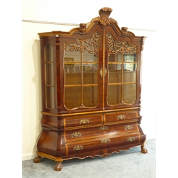 Dutch style figured walnut bombe display cabinet on chest, shaped moulded top with acanthus carved pediment, two doors with scroll carved mounts enclosing shelves, two short and two long drawers, on hairy paw feet, W202cm, H226cm, D46cm