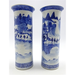 Pair of 19th century Chinese blue and white cylindrical vases decorated with figures and pagodas in a mountainous landscape with four figure Kangxi mark to base, H26cm