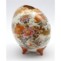 Japanese porcelain vase in form of an egg with floral shaped mouth on four butterfly shaped pedestal feet with signature to base H13cms