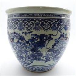 Large 20th Century Chinese blue and white jardiniere decorated with dragons, flowers etc H36cms, 40cms Diam