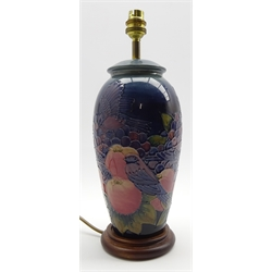 Moorcroft vase shape table lamp decorated in the 'Blue Finch' pattern and on a wooden stand H28cm