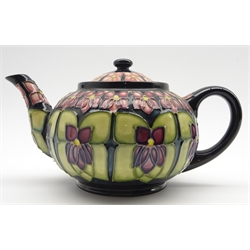 Walter Moorcroft teapot decorated in the Violet pattern, designed by Sally Tuffin, silver line
