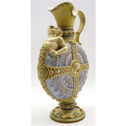 Rare Mettlach glazed nautilus ewer with a figure emerging from the shell and with applied strap work decoration on a shell moulded foot with date code for 1894 H40cm Notes (supplied by the Keramikmuseum): 'The so-called NAUTILUS-Jug has the decoration number 1123, and it belonged to the product range of our factory at Mettlach from 1881, the year of the registration of the design, until the beginning of the 20th century: the jug can be proved in the sales catalogues of 1885 and 1899. Your jug dates back to the year 1894. The sales price at that time has been 20,00 German Marks. 1123 is a relief jug decorated by hand painting, the material is stone ware.'