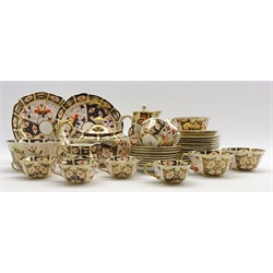 Royal Crown Derby Imari pattern tea set comprising 8 cups, 9 saucers, 12 tea plates, tea pot, milk jug, sugar bowl, 2 bread and butter plates, hot water jug, 3 breakfast cups and 2 saucers, pattern 2451 circa 1915