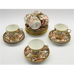 Set of 7 Royal Crown Derby tea cups, 8 saucers and 8 plates decorated with Japanese flowers in orange, blue and gilt, circa 1954