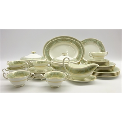 Wedgwood 'Gold Columbia' sage green pattern dinner service comprising 6 dinner plates, 6 dessert plates, 6 side plates, 6 soup bowls and stands, 2 vegetable dishes and covers, 2 oval meat plates and a sauce boat and stand 36 pieces