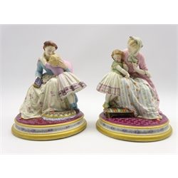 Pair of mid 19th Century Jean Gille Paris bisque porcelain figures of a mother and child on gilt circular bases H10cm with blue pad mark