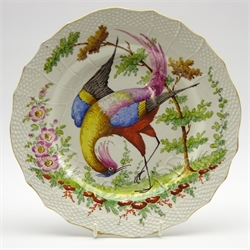 19th century Chelsea style plate painted with a bird within a moulded border and with gold anchor mark D25cm