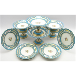 Coalport design dessert service painted with sprays of flowers within a blue and gilt border with retailers mark of Daniell, London comprising 8 plates D24cm, and 6 comports in 3 sizes (14 pieces)