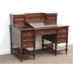Maple & Co. Ltd - Late Victorian mahogany 'Dickens' desk, top section fitted with small drawers, three sectional leather inset break front top with egg and dart carved edge, sloped centre section enclosing fitted interior, six drawers, turned supports joined by undertiers, locks stamped 'Hobbs & Co. London', W137cm, H105cm, D77cm