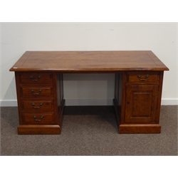Large oak twin pedestal desk, moulded rectangular top on panelled pedestals fitted with five drawers and cupboard, plinth base, 160cm x 80cm, H74cm