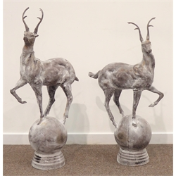 Pair cast metal garden stags on spherical mounts, figures/gate post finials, H91cm