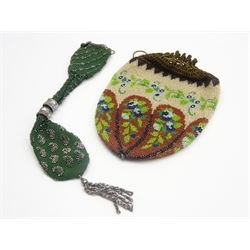 19th Century cut steel and silk miser's purse and a bead work draw string purse