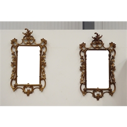 Pair of decorative reproduction gilt framed wall mirrors, with scrolling and floral design, 45cm x 105cm