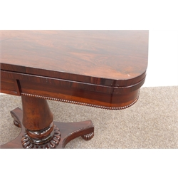 Two George IV rosewood card tables, hinged revolving top enclosing baize lined surface, beaded frieze above turned column support raised on quatrefoil base and fluted turned feet W92cm, H70cm, D92cm