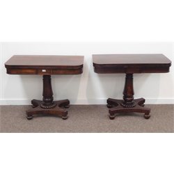 Two George IV rosewood card tables, hinged revolving top enclosing baize lined surface, beaded frieze above turned column support raised on quatrefoi
