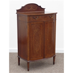 Edwardian inlaid mahogany bow front music cabinet, stepped arched raised back, single drawer above two panelled doors enclosing four sliding shelves,
