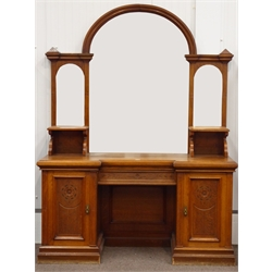 Large late Victorian oak mirror back sideboard, arched mirror back with two bevelled plates either side, reverse break front top with chamfered edge,