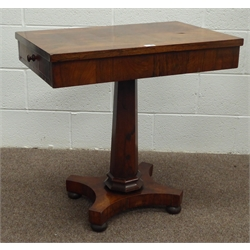 19th century rosewood side table, rectangular cross banded top above two drawers to each end, tapered octagonal pedestal, platform base, turned bun f