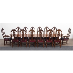 Quality Queen Anne style burr walnut triple pedestal extending dining table, rounded rectangular cross banded top with moulded edges and carved floral decoration, raised on cabriole supports with two additional leaves, (394cm X 106cm, H75cm) together with Set fourteen (12+2) high back walnut dining chairs, carved acanthus and scrolled cresting rail, baluster shaped pierced splat, further scrolled and floral decoration on arm terminal and supports, two tone red silk upholstered seat cushions, raised on cabriole legs, (W59cm, H131cm, D47cm)