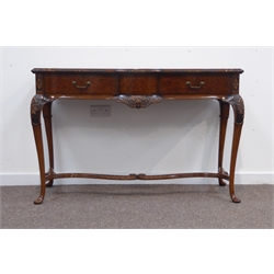 Quality reproduction burr walnut serpentine serving table, rectangular cross banded top moulded and carved with floral decoration, two frieze drawers centred by shell and scroll decoration, cabriole supports joined by scrolled carved and moulded stretcher, W129cm, H84cm, D56cm